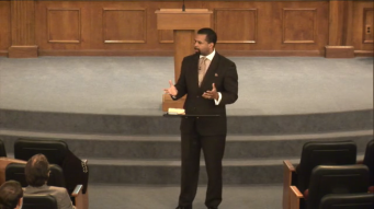 preaching in the brown suit.