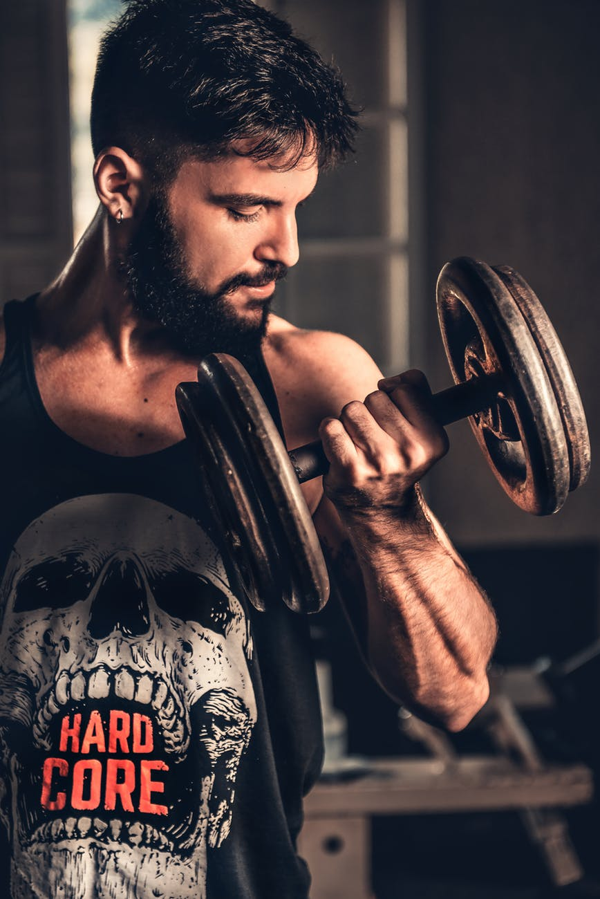photo of man lifting dumbbell